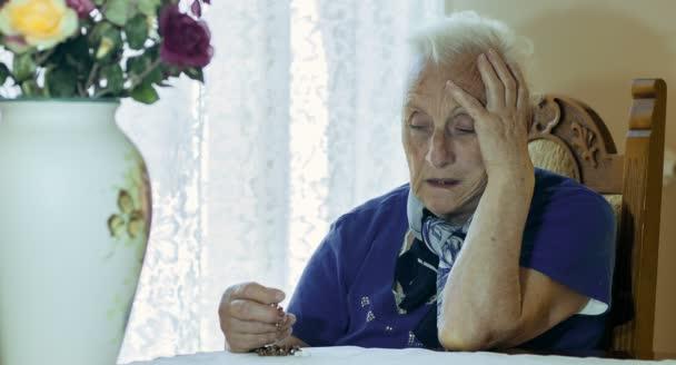 sad and depressed elderly woman , old woman