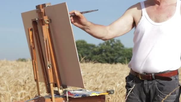pan from a painter to ears of wheat