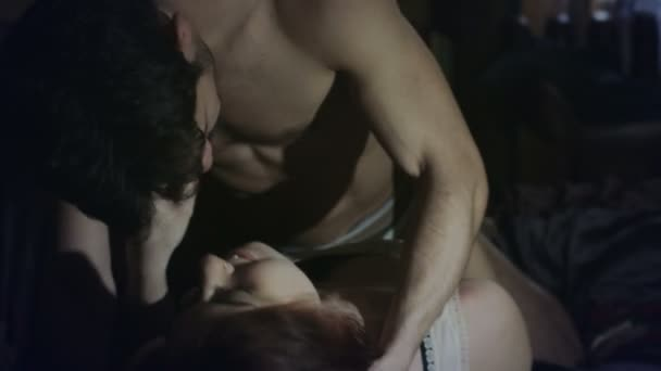 Young couple passionately making love