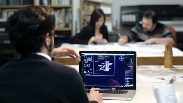 team of architect at work on blueprints and also using modern cad software