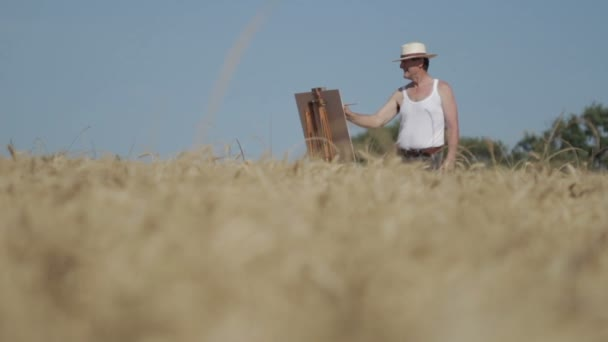 painter in the middle of a cornfield paints a beautiful landscape, canvas, easel