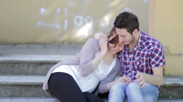 a man gives a bracelet to his girlfriend and she kisses him