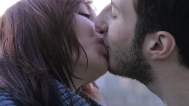 Close up of an attractive young couple kissing