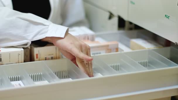 pharmacist taking medicines from the drawer