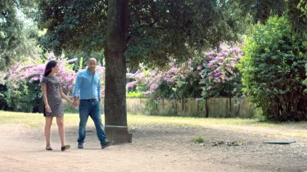 couple is having a romantic walk in the park; couple kissing
