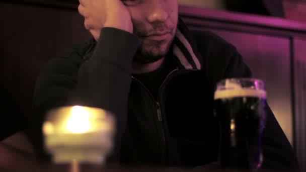 Portrait of depressed young men drinking beer at the pub