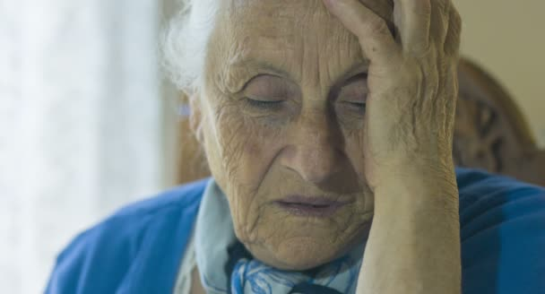 desperate old woman: sad and worried old woman