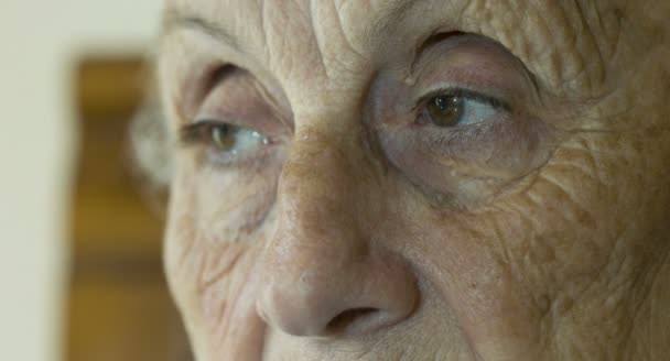 elderly woman open and close eyes   old eyes ,large wrinkles