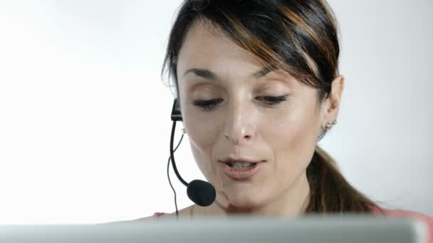 call center operator: young woman working with computer and headset