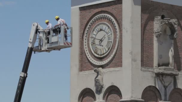 construction worker on boom lift to work on the bell tower of a church - crane -