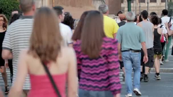 crowd of people crossing street on zebra strips: city center, men, woman, day- Rome, Italy,8 June,2014