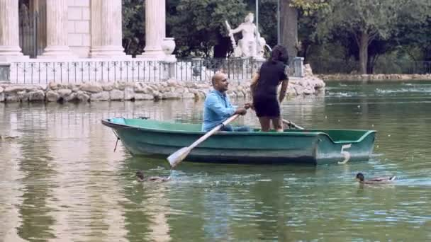 young couple in love on a little lake: rowboat, villa borghese, Rome, love