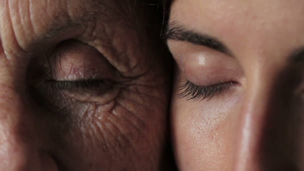 old and young eyes - Women portrait with grandmother and daughter -  open eyes
