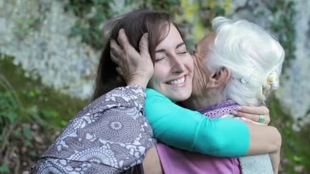 Grandmother and granddaugh giving each other a cuddle full of love and affection