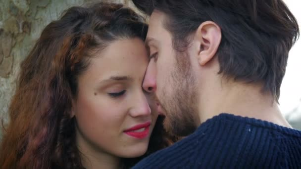 young lovers kissing: people having tender moments with sweet kisses