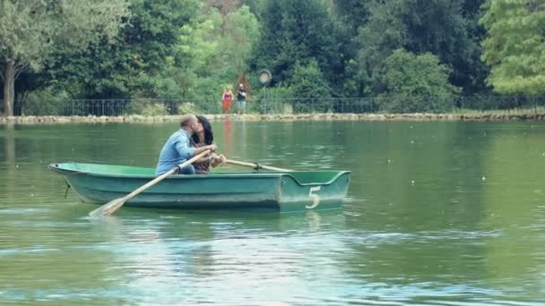 couple in love on the rowboat in Rome: villa borghese, park, garden
