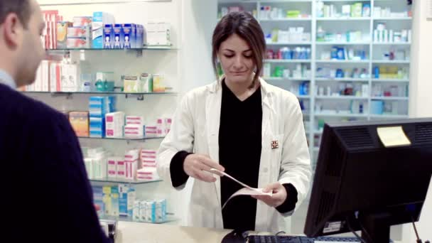 Pharmacist taking medicines for customer