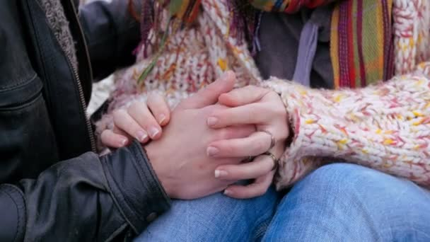 a loving couple holding hands and kissing, caressing, loving each other