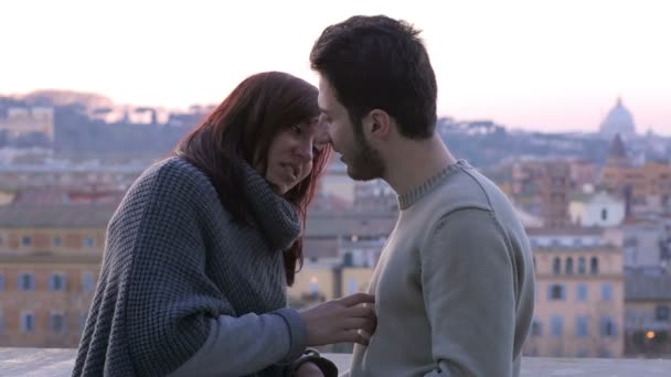 young couple in love in Rome: engagement, caresses, hugs, romantic partners
