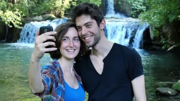 couple making selfie near a river