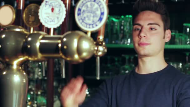 barman pouring pint of beer