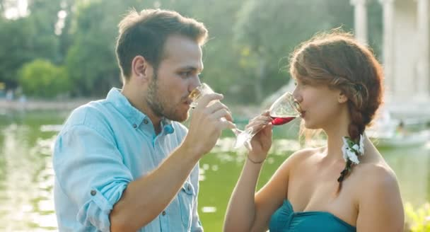 Romantic Couple In Love Making A Toast Near Small Lake Love Date Drinking