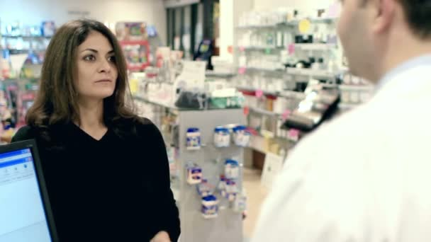 pharmacist giving a drug to a customer