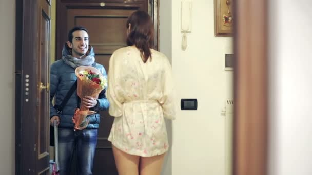 The man returns home to surprise, but his girlfriend is with a man