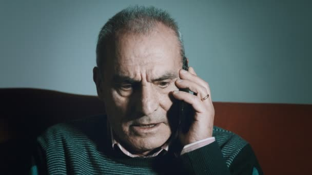 Old Man Is Having An Angry Phone Call With Mobile Phone Stock