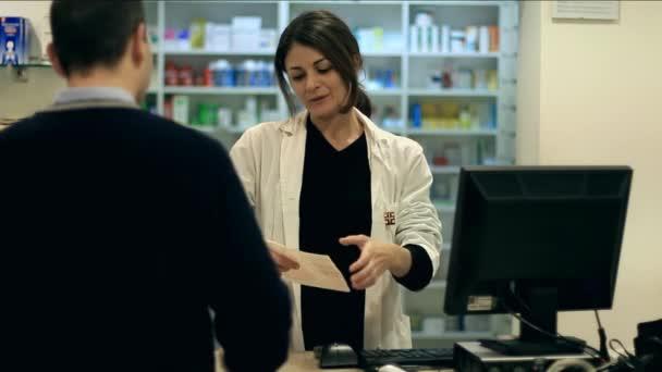 Pharmacist taking medicines for customer