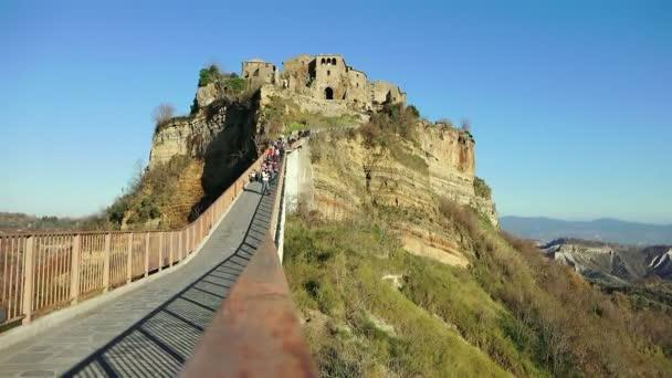 people walking on the bridge to Civita di Bagnoregio