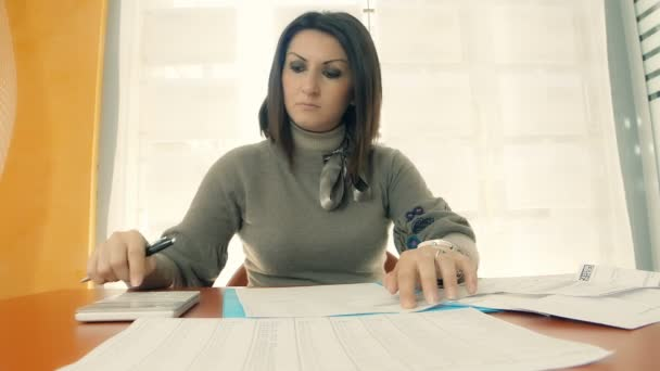 accountant at work with calculator and documents
