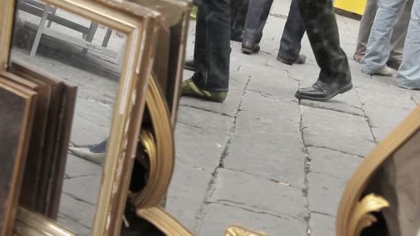 People walking between the mirrors