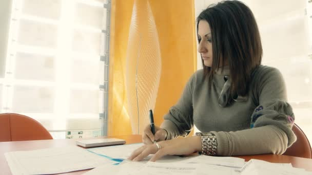 businesswoman at work with problems on the budget with calculator
