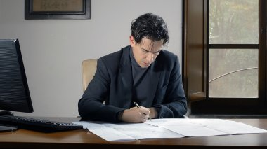 Focuse Business man writes a work document