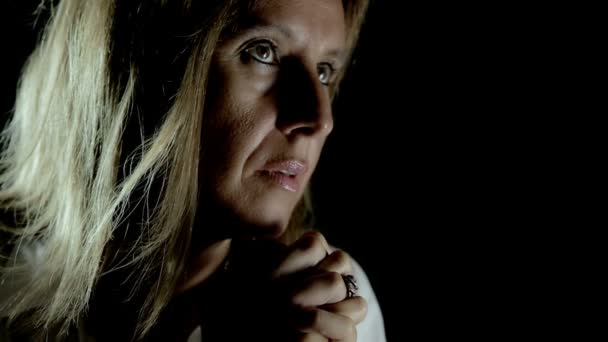 woman in prayer: woman in the darkness searching for god