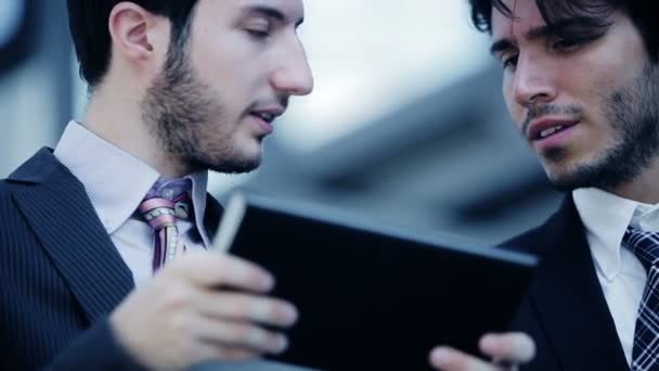 team work of businesspeople using  mobile device like tablet computer
