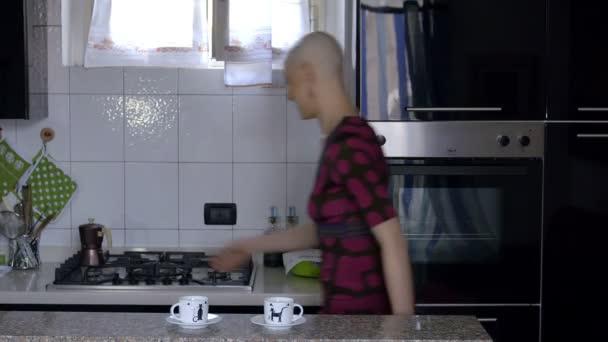 woman cancer survivor prepares coffee at home: relax, life, faith, vitality