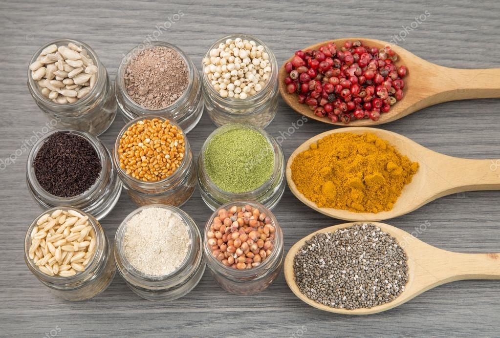 Variety of spices and grains on wooden background