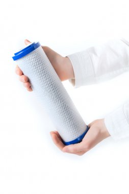 water filter cartridge in human hand