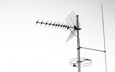 directional antenna for reception of digital television broadcasting DVB-T and DVB-T2 on a white background  (horizontal polarization, UHF, Delayed conductor, FM antenna)