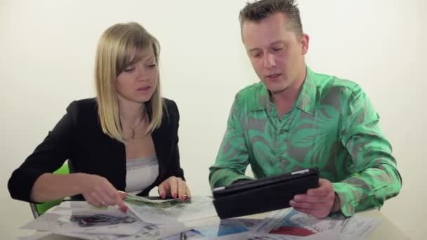 business partners working with tablet