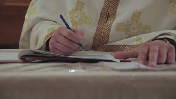 the Priest Wrote in a Notebook