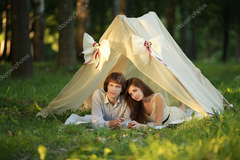 Summer evening in love couple lay inside cute tent at the park. u2014 Stock Photo  sc 1 st  Depositphotos & Summer evening in love couple lay inside cute tent at the park ...