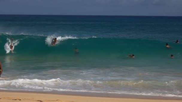 WAIKIKI, UNITED STATES OF AMERICA - AUGUST 6 2015: slow motion shot of bodyboard surfers at sandy beach, hawaii