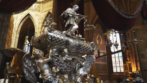 PRAGUE, CZECH REPUBLIC - OCTOBER, 10, 2017: statue on the tomb of john of nepomuk in st vitus cathedral, prague