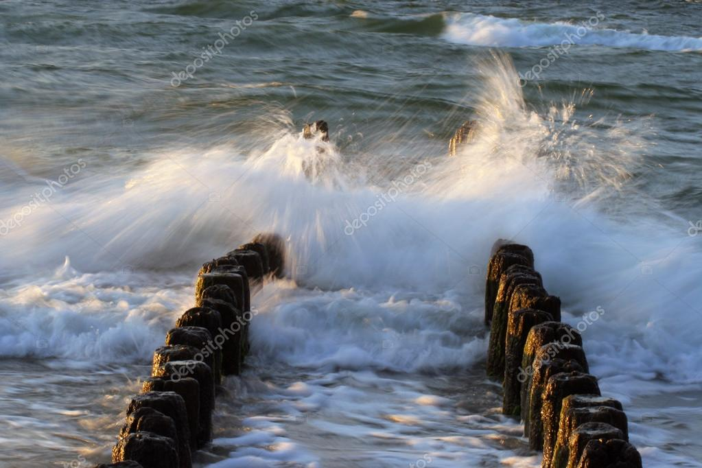 Breakwater and waves on a windy day