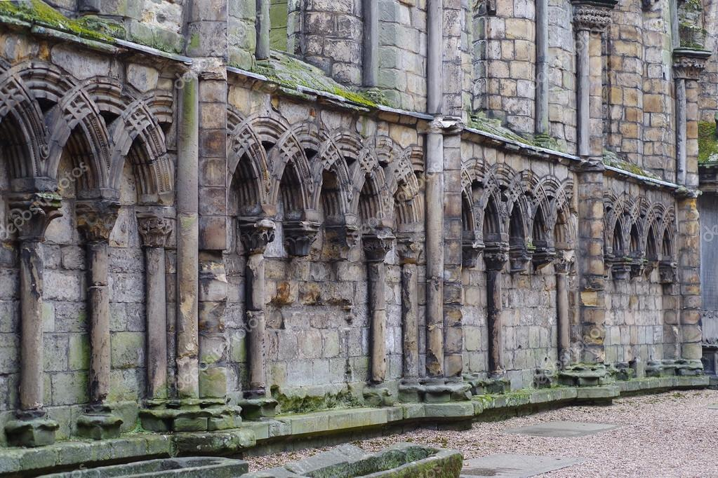 Ancient Gothic Stone Wall With Arches And Columns Stock Photo