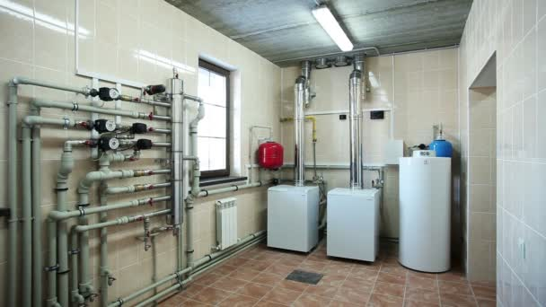 Boiler-house in private home. Heating system. Gas boilers in boiler room