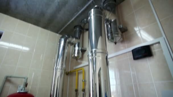 Boiler-house at home. Heating system. Gas boilers in boiler room. Metal flues.